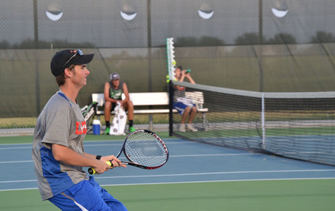 Senior Russell Thomas gripping his tennis racket, preparing for the opposing team to shoot the ball back. They would then lose three consecutive games.