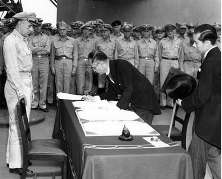 Japanese official signs the surrender papers on the USS Missouri on September 2, 1945.