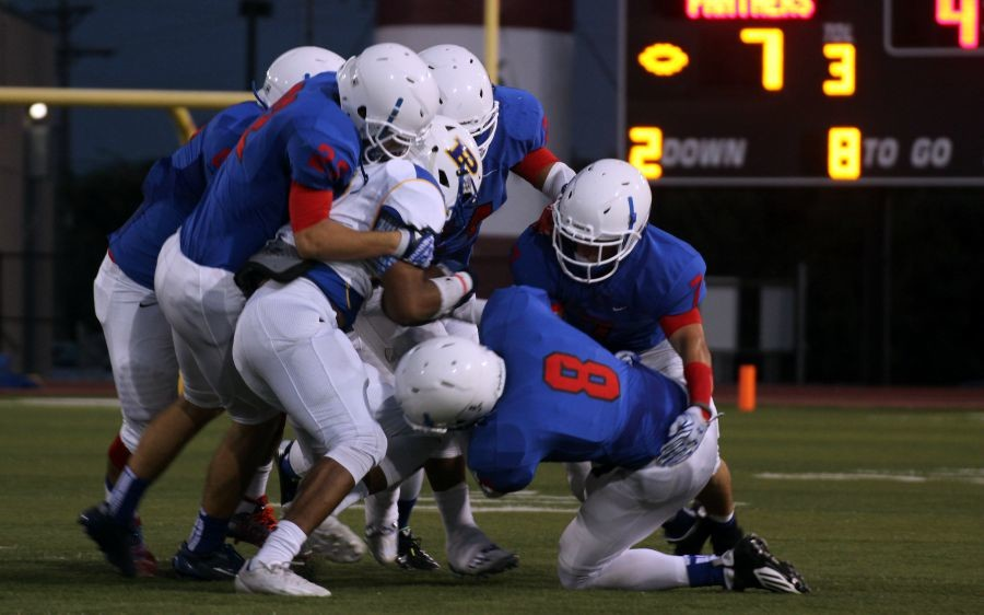 The Lions defense tackling a Pflugerville player. The defense would get six turnovers during the game.