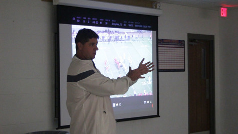 Head Coach Tim Smith talking about the deep touchdown pass during the Georgetown game. The coaches review last week