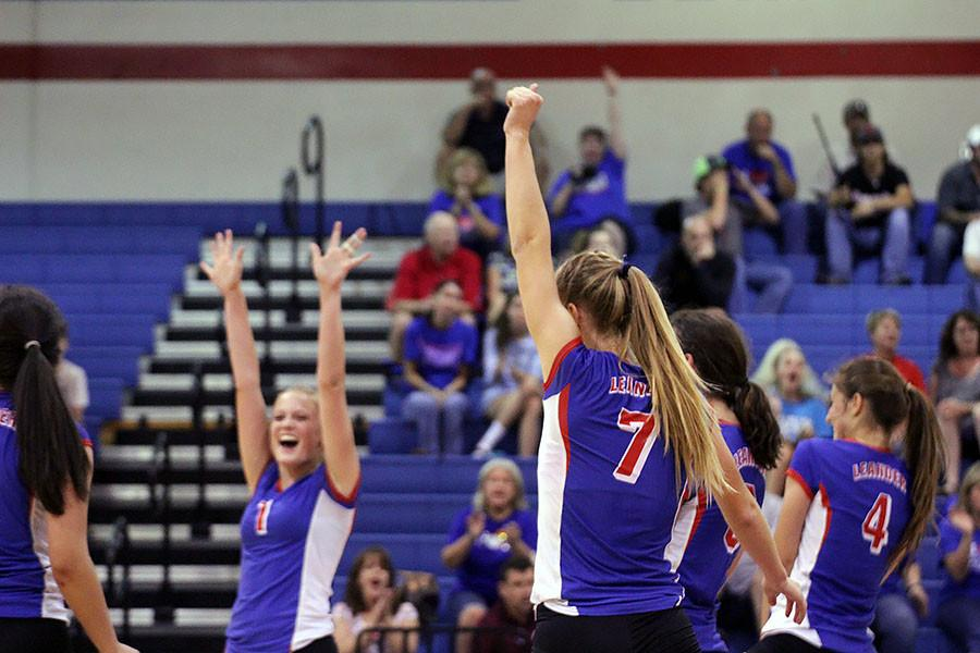 Senior Callie Reed throws her fist up after scoring in her games. The Lady Lions  won all of their sets, sweeping the Lady Mustangs.