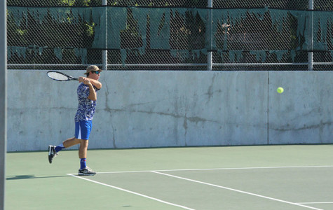 Senior Ricardo Acosta hitting the ball back to the opposing team. They would be eliminated from district on October 6.