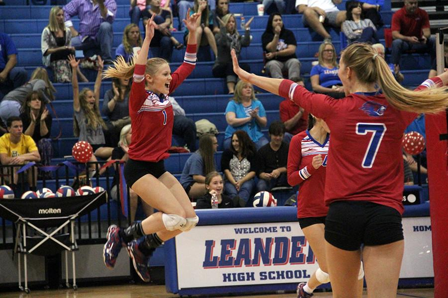 Senior Laurann Lane celebrating after a score. She is a four year veteran of the Lady Lion volleyball program.