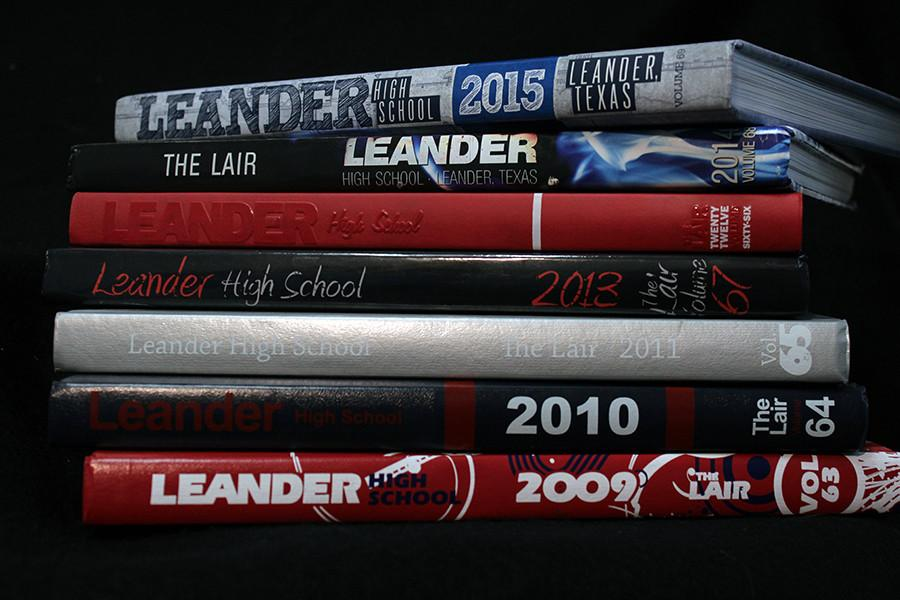 The Lair's yearbooks from 2009 until 2015. Over the years the size of the books have grown.