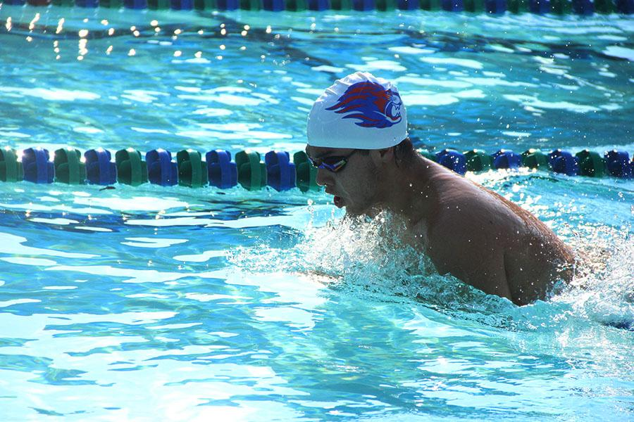 Swimmer swims at the McNeil and Rouse meet. Boys team ended the home meets with six wins and three losses.