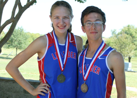 Seniors Claire Crone and Rob Coe posing for a photo after the meet. Coe and Crone will both go to Regionals.