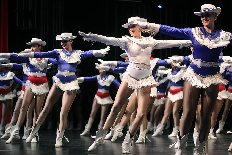 Senior Kelli Dyer and the other Blue Belles perform their final routine for iDance.