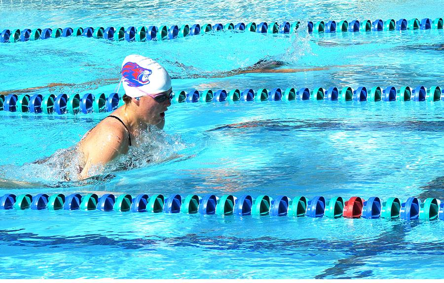 A swimmer swims breaststroke. Their first victory of the season was against Rouse/Meridian.
