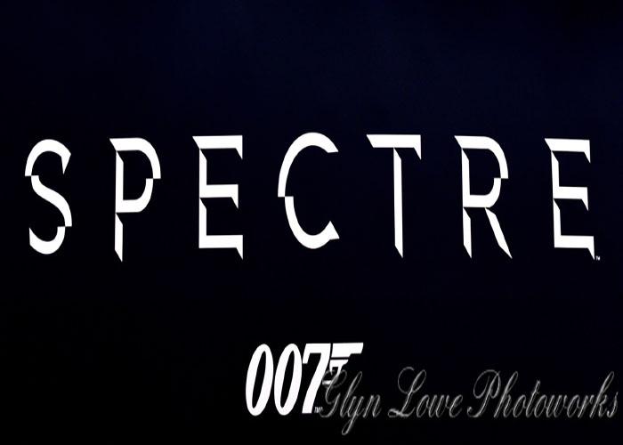 The title card for the new film. It stars Daniel Craig, Christoph Waltz,  Léa Seydoux, and Ralph Fiennes and is rated PG-13.