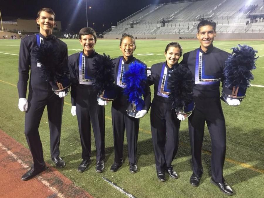 The+five+drum+majors+after+a+performance.+From+left+to+right%3A+Caleb+Greenstreet%2C+Hunter+Reinhardt%2C+Lilian+Pham%2C+Taylor+Pirtle%2C+and+Tristen+Banuelos.