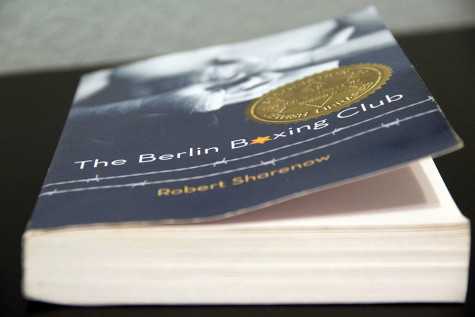 The Berlin Boxing Club is 418 pages total. The author, Robert Sharenow, is also a huge TV producer for A&E.