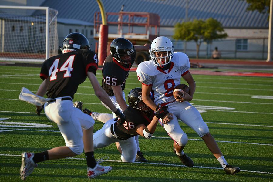 Sophomore quarterback Josh Rude running the ball. Rude finished the season with 5 rushing touchdowns.