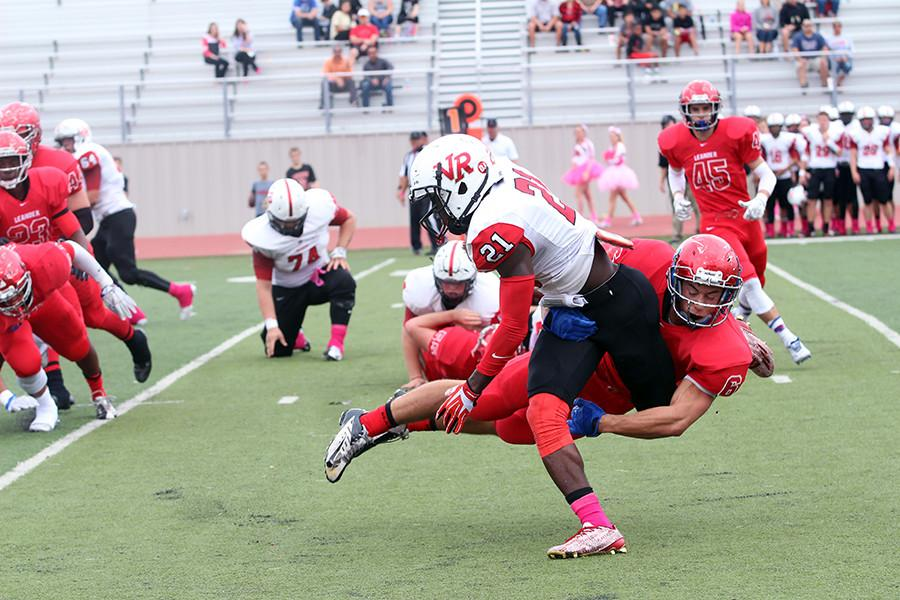Senior Matthew Long tackling a Vista Ridge runner. The Lions' defense forced two fumbles in the game.