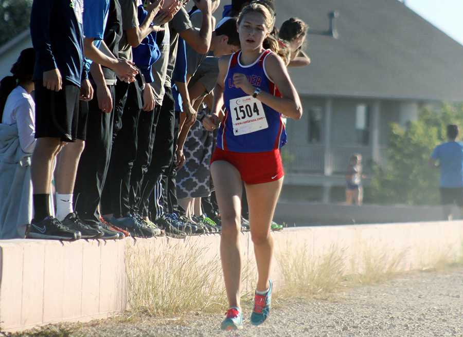 Senior Claire Crone running at the district meet. Both her and senior Rob Coe will be going to the state meet.