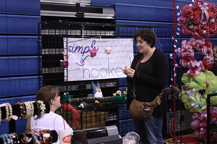 One of the many vendors at the Craft Market. The craft market is held by the baseball booster club.
