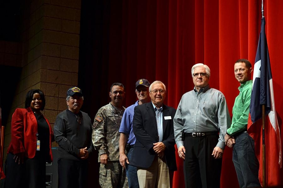 The veterans with principal Tiffany Spicer. Veterans and dependents of veterans were honored at the ceremony.