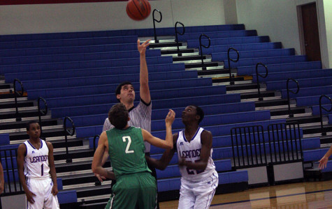 Junior Kevone Graham during the tip-off of the game. He turned out successful in directing the ball to his side.
