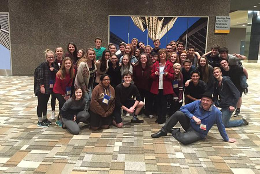 Troupe 5232 at the end of convention. Linda Major is standing in the middle of the crowd and holding her award for being inducted into the Thespian Hall of Fame.