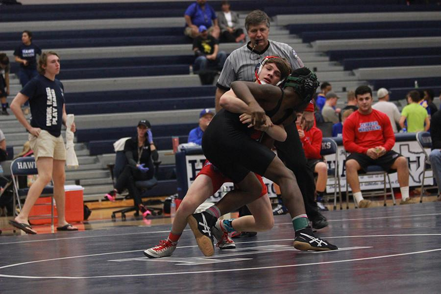 John Geiger wrestling for Leander in the Pflugerville Tournament. He went undefeated during the meet.