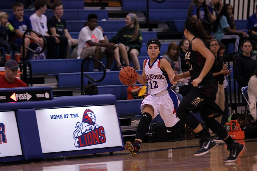 Sophomore Madison Lawton dribbling down the court. Lawton scored six points in the game.