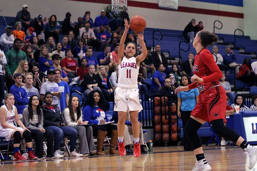 Sophomore Kassadie Sanders goes to take a shot. She scored 2 points against Vista Ridge.