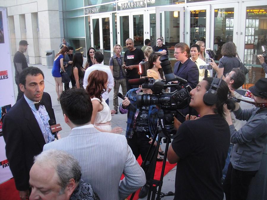 Actors on the red carpet being interviewed.