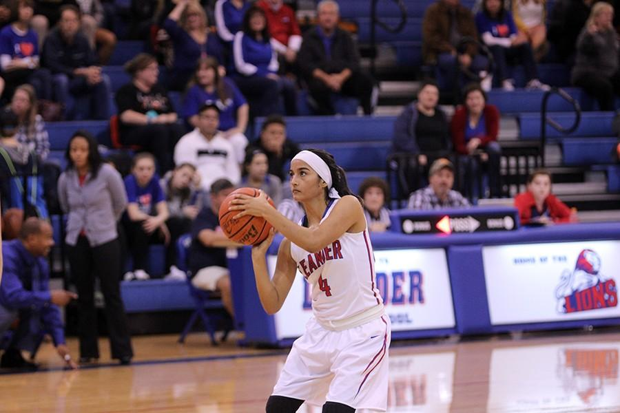 Senior Izaila Martinez begins to take a shot. She scored 10 points against Eastview.