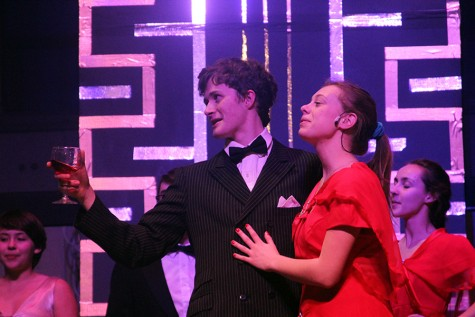 """Juniors Matthew Kennedy and Ana Arthur during the scene 'Public Enemy Number One'. In this scene the passengers give thanks to """"public enemy number one,"""" Snake Eyes Johnson, who is really Billy Crocker."""