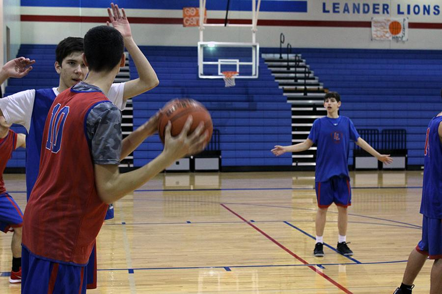 Junior Blane Smith blocking during practice. The boys are training for their next opponents, Marble Falls.