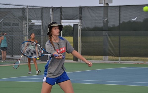 Madison Flesner hitting a tennis ball back to the opposing side. They would win 8-2.