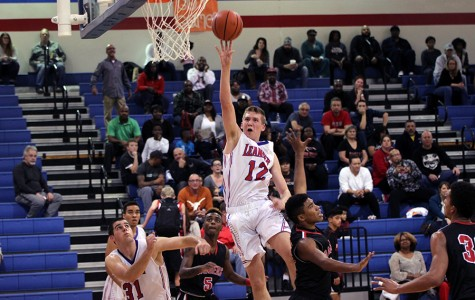 Junior Chase Cotton shooting for two points against Vista Ridge. Cotton scored 16 points in the game.