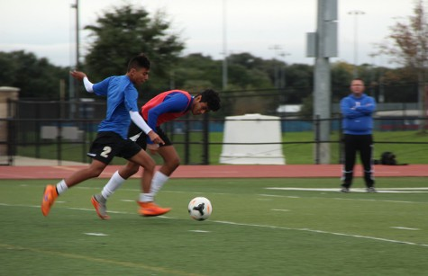 Freshmen Eduardo Escobedo beats his defender during practice. There are 5 freshmen this year on varsity.