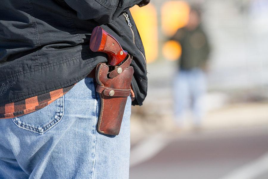 The new law took effect on January 1st. It permits people like in this picture to openly carry their guns in public.
