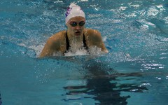 Student swims at a university pool.  After state the swim team ranked 15th.