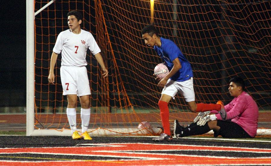 Senior Ruben Gonzales grabs the ball out of the net after scoring with a minute left. However, the time ran out before they could tie it up and they lost 2-1.