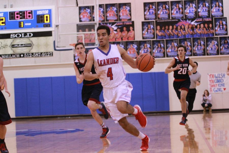 Senior David Bonner dribbling down the court against East View last night. Bonner scored eight points total in the game.