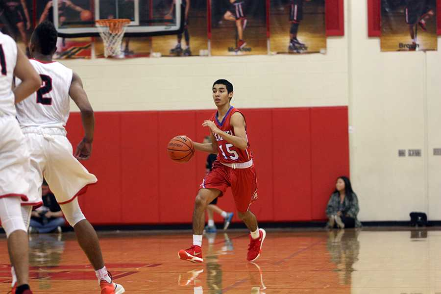 Sophomore Ruben Luna dribbling down the court against Vista Ridge. The Lions play Dripping Springs next for senior night.