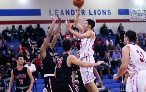 Junior Kobe Thompson shooting for the basket against Vista Ridge. The Lions will play against the Rangers this Friday.