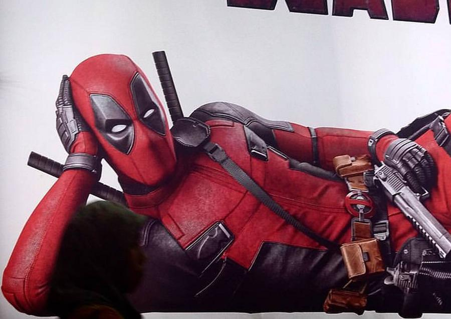 Ryan Reynolds in the Deadpool costume. People see it through out the entire movie.