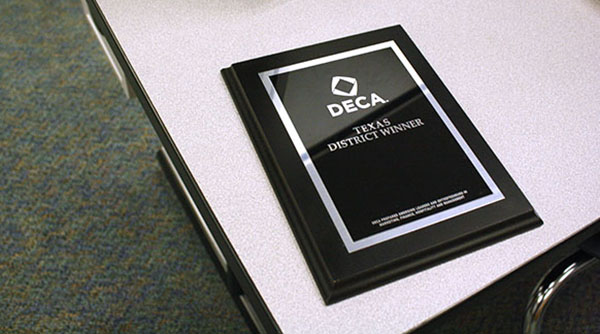 A plaque won by a DECA member. Multiples will be engraved and left in Ms. Groomes' classroom.