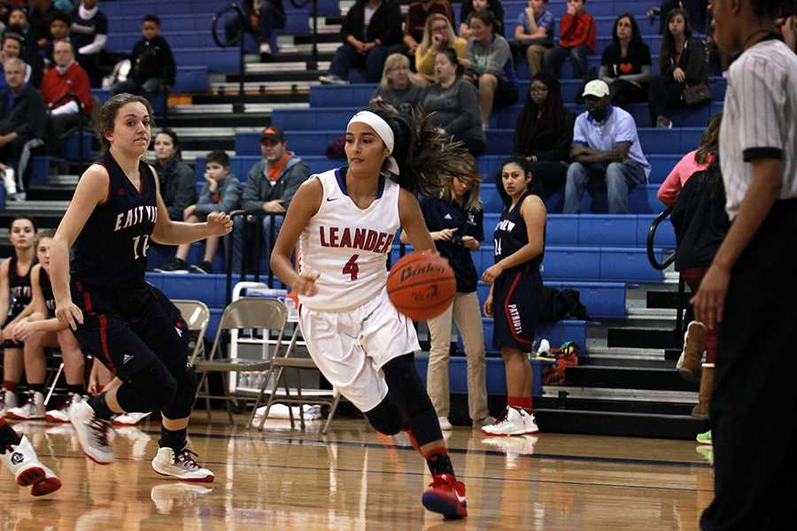 Senior Gigi Martinez dribbling down the court against East View. Martinez and senior Rayanna Carter scored a total of 24 points.