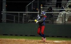 Senior Gabby Walton hitting the ball against Rouse. Walton's bunt, and senior Hailey MacKay's hit helped start a comeback in the seventh inning that led to the Lady Lions win.
