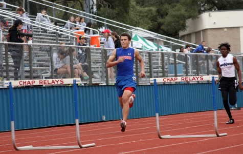 Sophomore Lukas Boeck running hurdles. The whole team practices outside at Bible Stadium.
