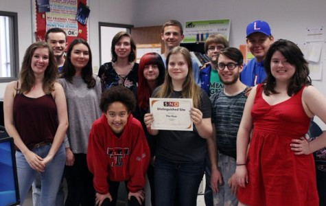 The entire newspaper staff after receiving their SNO Distinguished Site award. The newspaper has also been nominated for an ILPC Star for the current year.