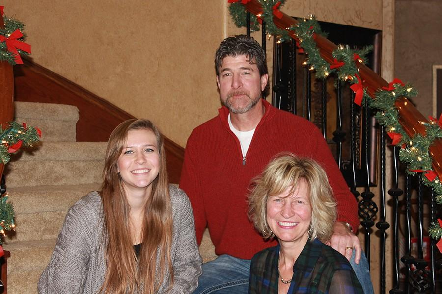 Mrs.+Flesner+%28bottom+right%29+with+her+husband+Jerry+and+daughter+Madison.+Madison+is+currently+a+senior+at+Leander.