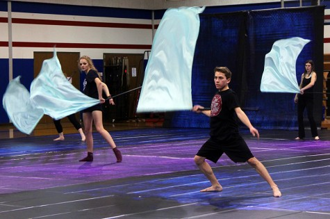 The Winter Guard practices their routines. Winter Guard is individual performances while Color Guard is with band in the fall.