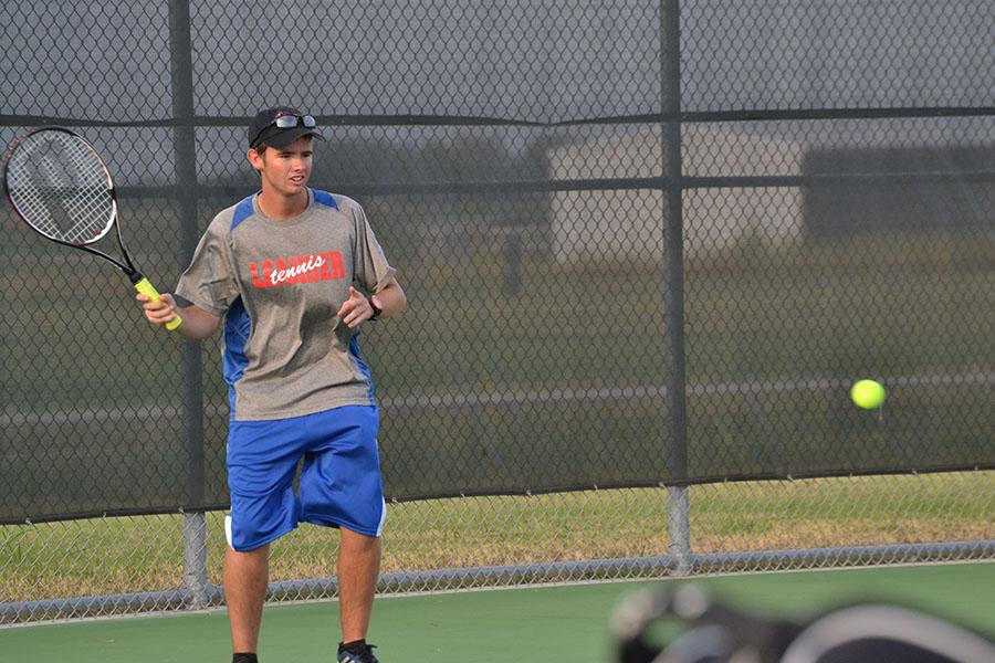 Russel Thomas engaged in a match against an opponent. The Girls' Doubles and Mixed Doubles walked away victories this week.