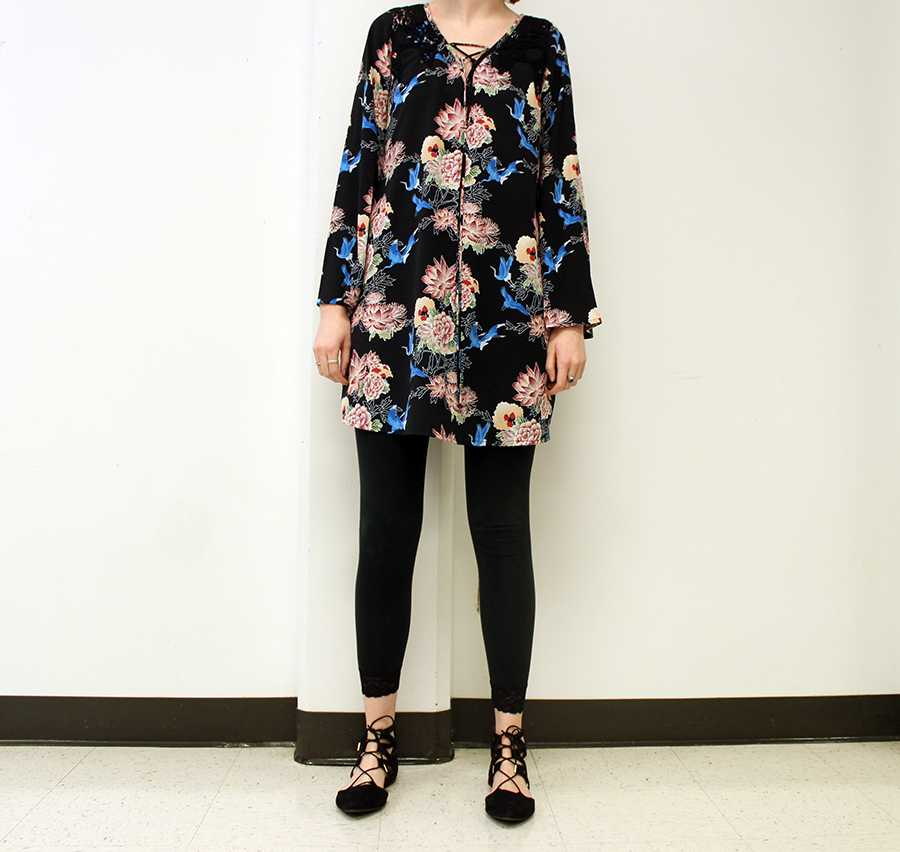 Student wears a floral dress with leggings and lace-up pointed shoes. They shoes can be found at Target.