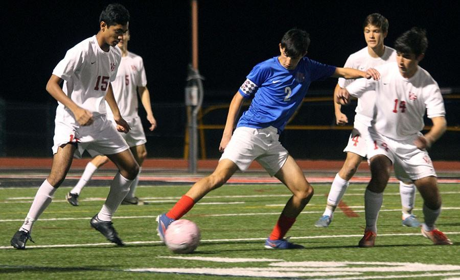 Senior Dallas Sullivan takes on Vista Ridge defenders. He was one of the assisters in the Georgetown game.
