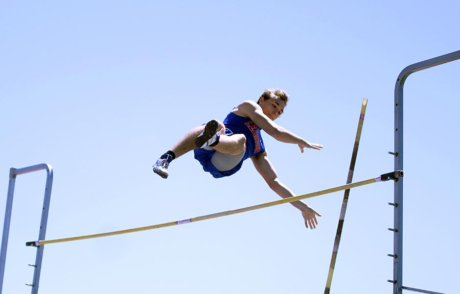 Junior Derek Voss competing in pole vault. His best jump to win first was 13 feet and 2 inches.